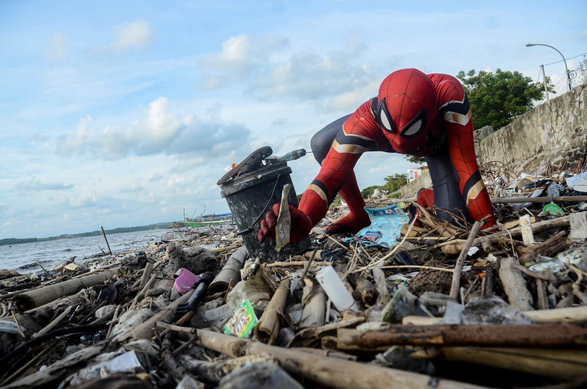 Dressed as Spider-Man, Rudi Hartono collects rubbish at a beach in Parepare, South Sulawesi...