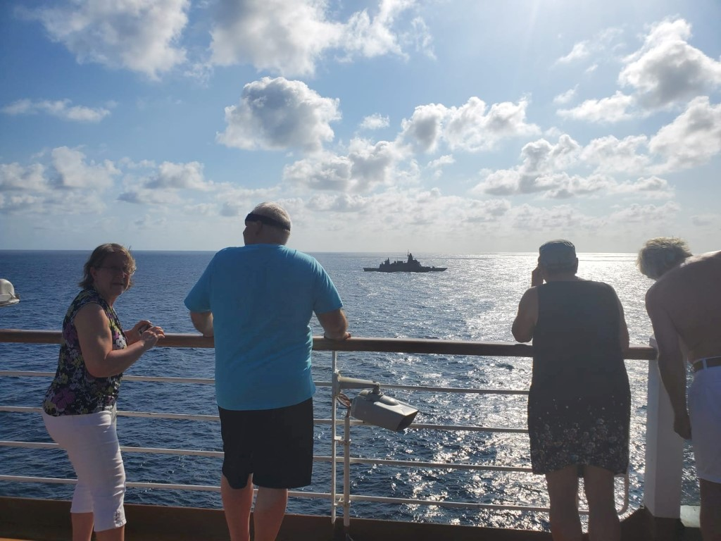 Passengers on board MS Westerdam watch Thai navy stealth frigate HTMS Bhumibol Adulyadej in...