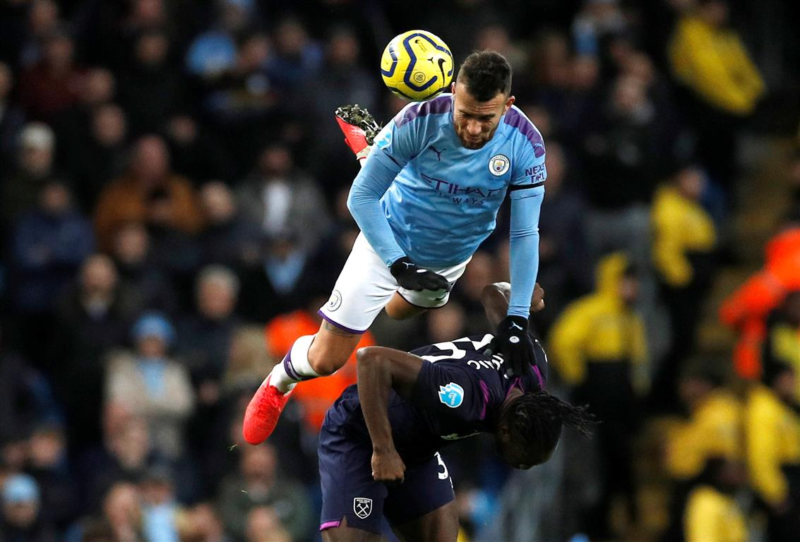 Manchester City's Nicolas Otamendi in action with West Ham United's Michail Antonio. Photo:...
