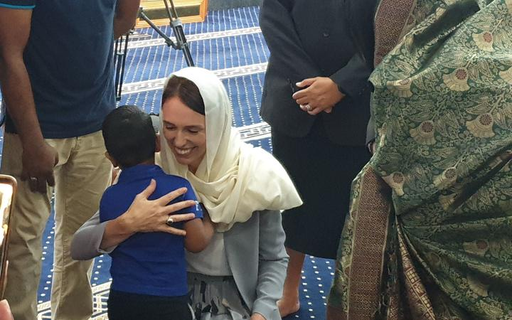Jacinda Ardern hugs the great grandson of Ashraf Ali Razak, who died in the March 15 attack....