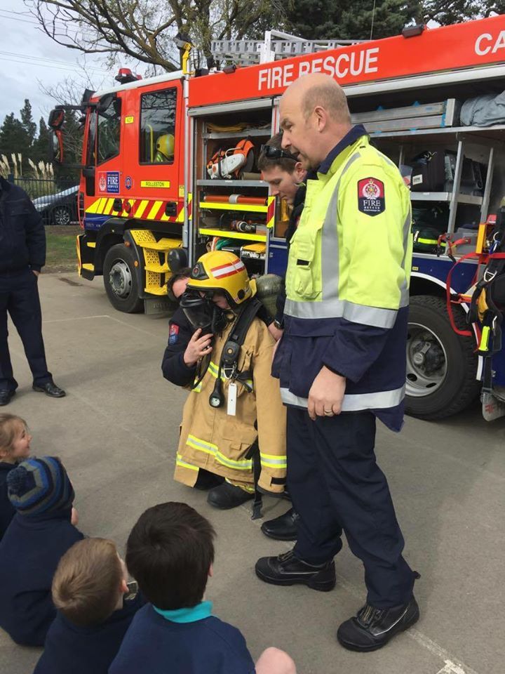 Cam Kenyon with Weedons School pupils helping them complete their fire-wise programme. Photo:...