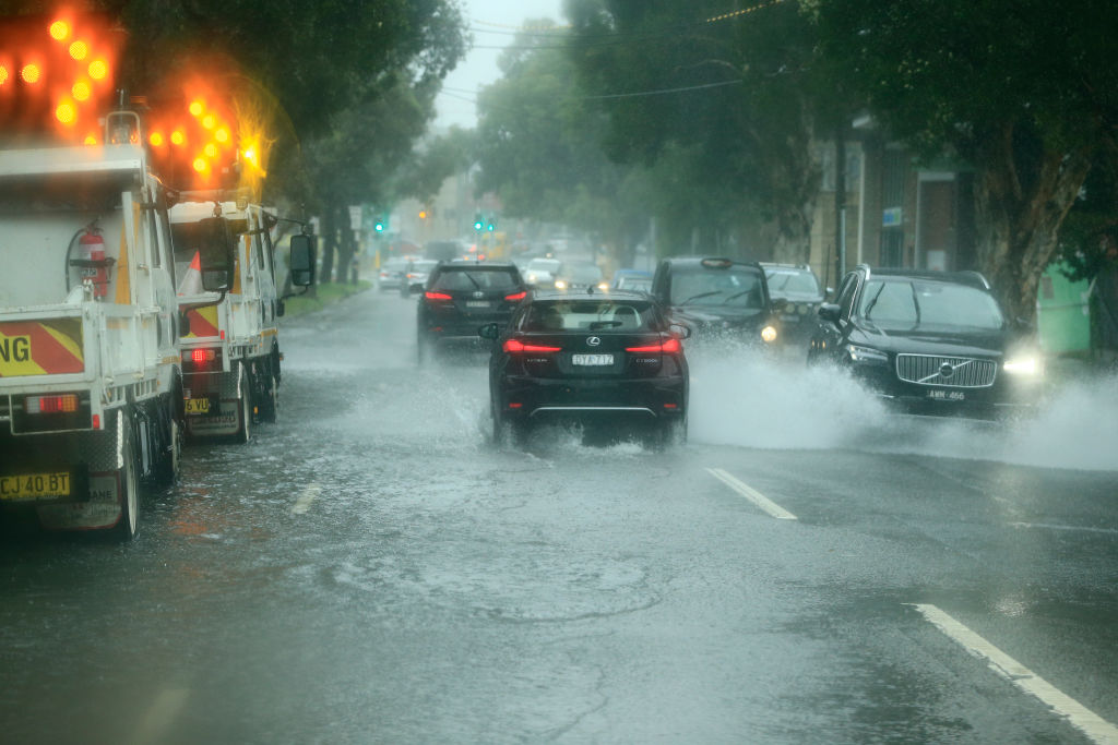 Cars travel through flooded roads in Sydney earlier this week. Photo: Getty Images