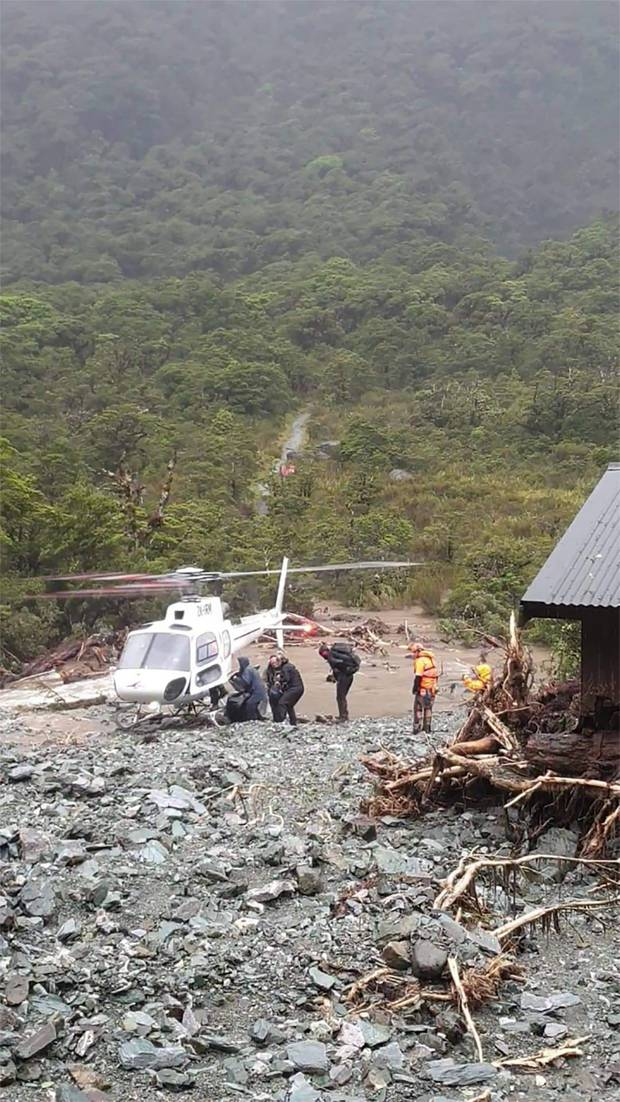 Trampers rescued from Howden Hut on the Routeburn Track on Tuesday. Photo: Grace Houpapa