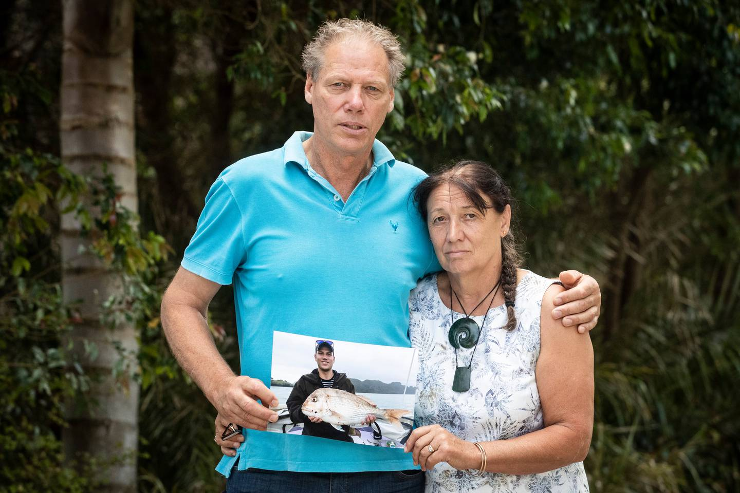 Kerry and Jenny Rogers hold a photograph of Tim, who died hours after a fall at Auckland's...
