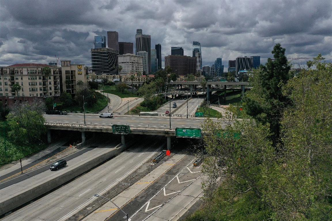 A view of the 110 freeway and downtown Los Angeles the day after California issued a stay-at-home...