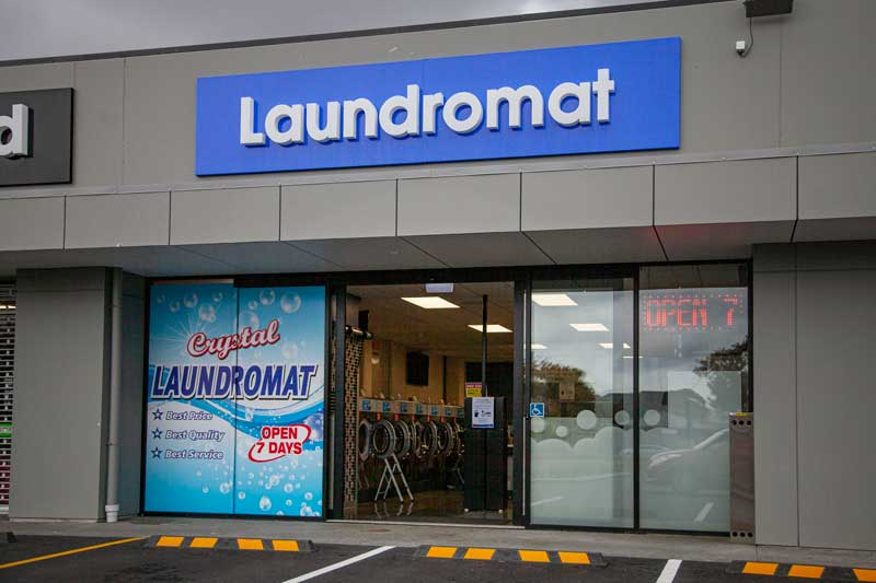 Crystal Laundromat on Fitzgerald Ave is open. Photo: Geoff Sloan