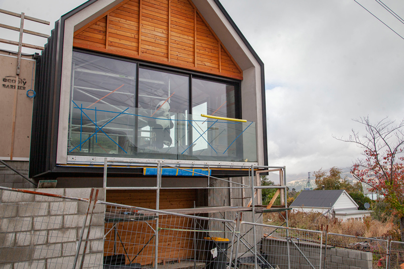 Panda on guard at a build site in Lyttelton.