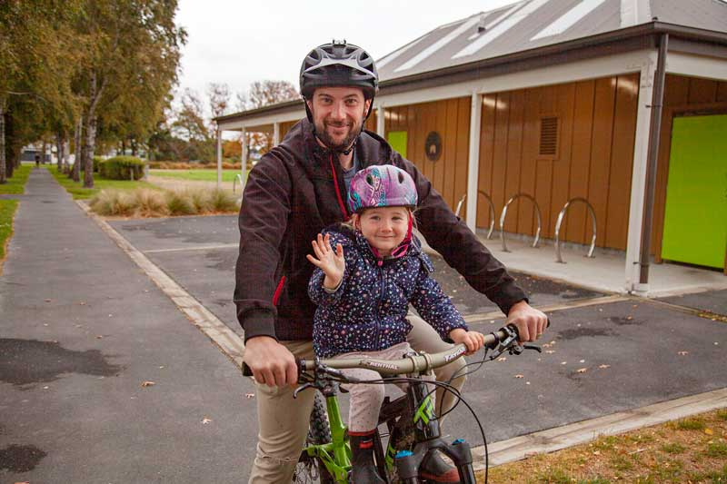 Andrew Peck and his daughter Myka Peck, 3, of St Albans get some exercise and have fun while...