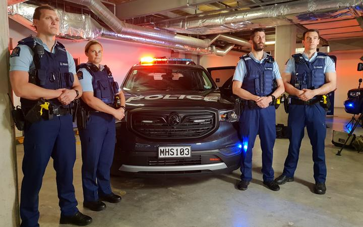Police officers with one of the Armed Response Team vehicles. Photo: RNZ / Liu Chen