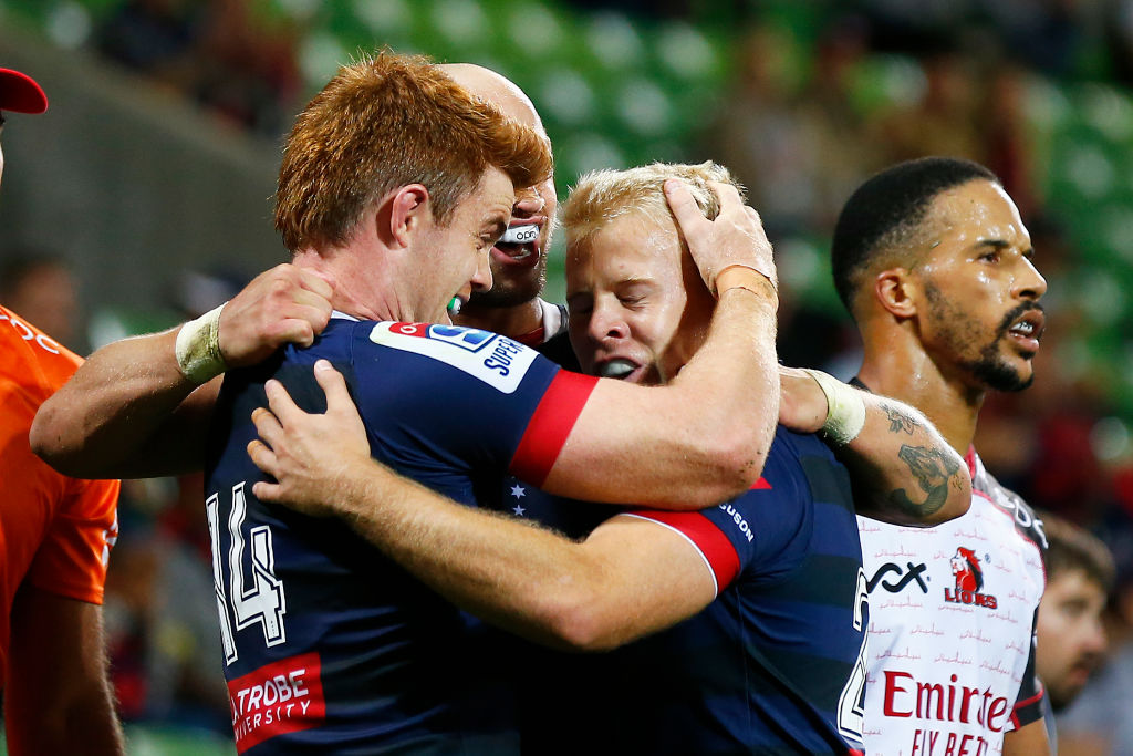The Rebels' Andrew Kellaway (L) celebrates a try against the Lions. Photo: Getty