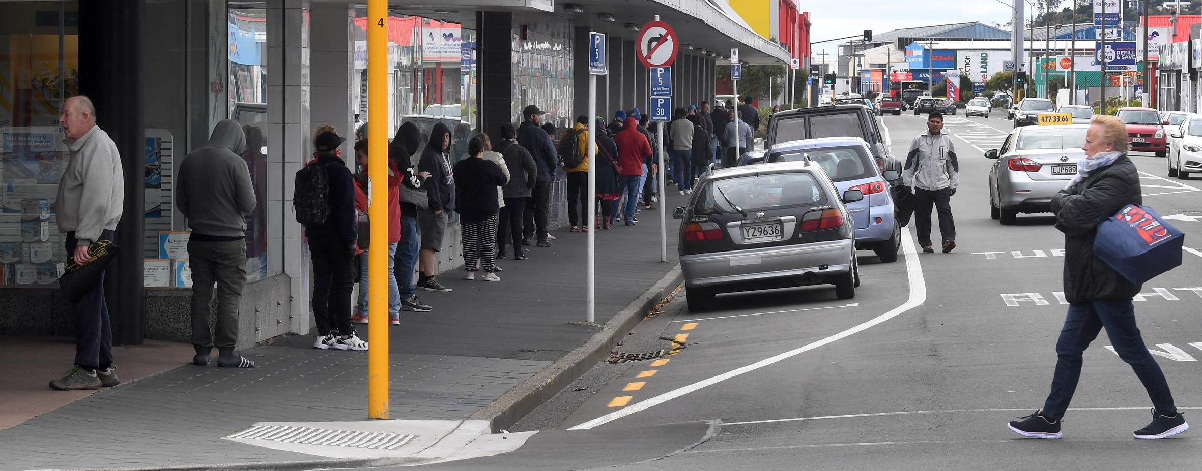 A long queue stretches out of Pak 'n Save in Dunedin and along Hillside Rd at lunchtime. PHOTO:...