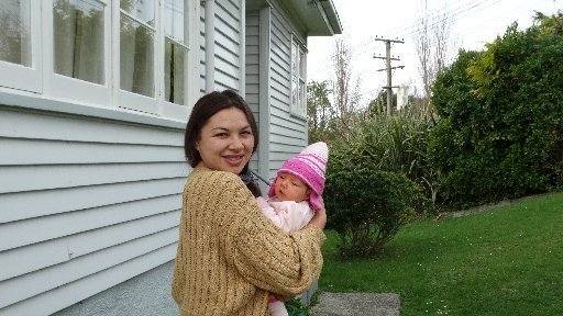 Geane Nelio, with five-week-old daughter Esmakia Smith, is grateful for the quick response of...