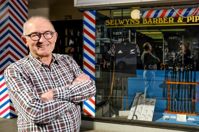 Selwyn Grave outside his barber shop in Moray Place. Photo: Suuplied