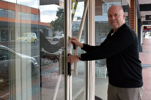 Rumah co-owner Lee Macaskill locks the door of his shop, ending nearly four years of retailing in...