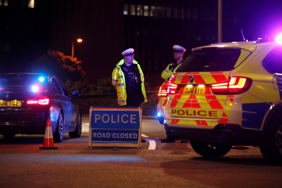 Police at a cordon in Reading following the attack. Photo: Reuters