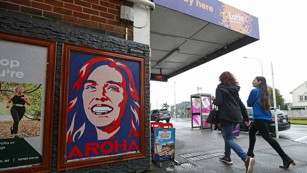 A poster of Prime Minister Jacinda Ardern, Aroha, outside a dairy in Auckland. Photo: NZ Herald
