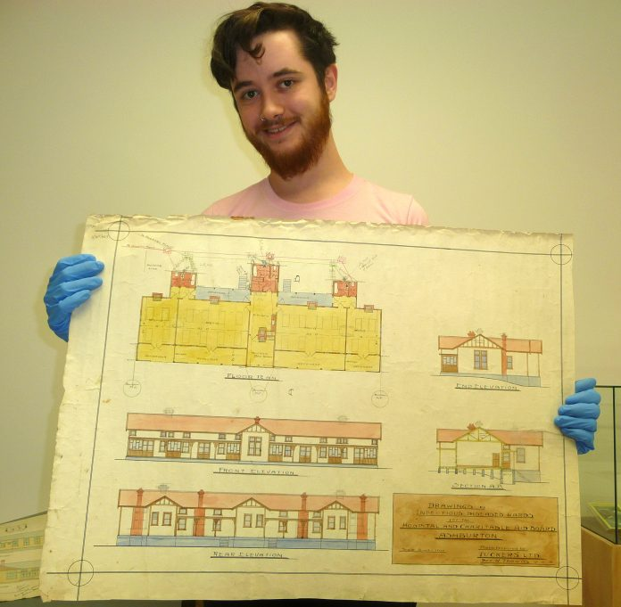 Ashburton Museum archives officer Connor Lysaght with Billy Thomas's drawings of the infectious...