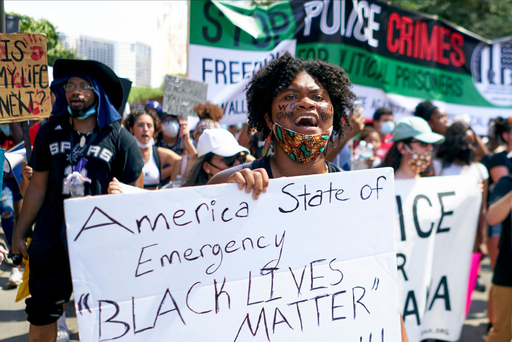 Demonstrators march in Dallas, Texas during a protest against police brutality and racism. Photo:...