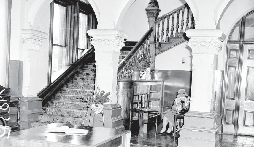 This photo, taken between 1960 and 1962, shows the ground floor and a staircase leading to the...