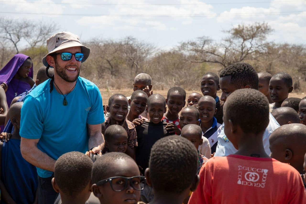 Cathal McLoughlin from Queenstown greets Tanzanian locals in the award-winning film The KFC....