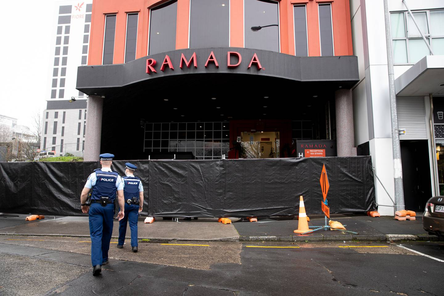 Four vans could be seen dropping off Australian deportees at the Ramada Suites by Wyndham...