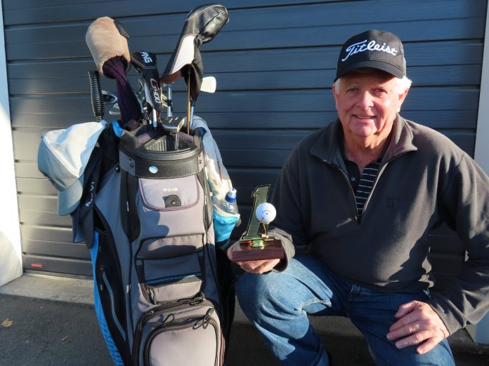 Ashburton Golf Club member Peter Walker with his special hole-in-one ball. Photo: Supplied