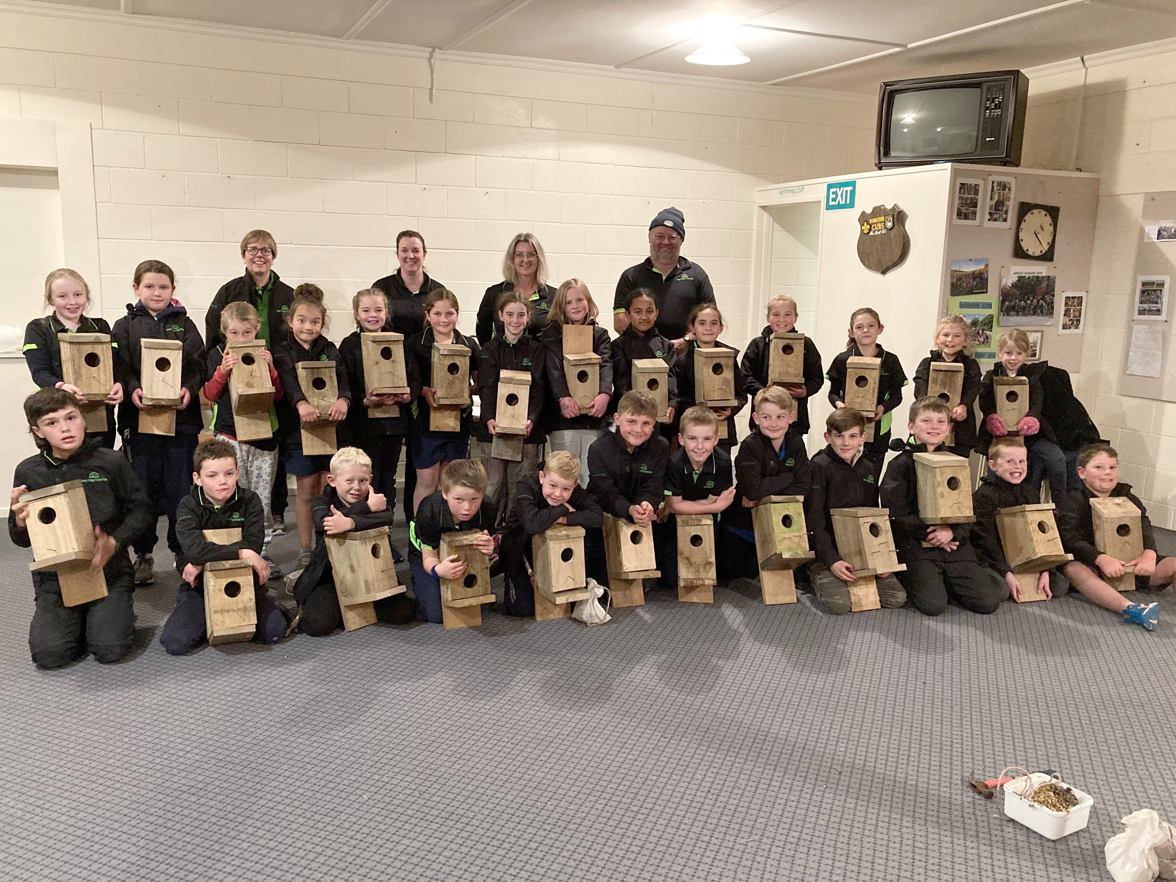 West Otago Rural Kids members and adult leaders show off their bird boxes ...