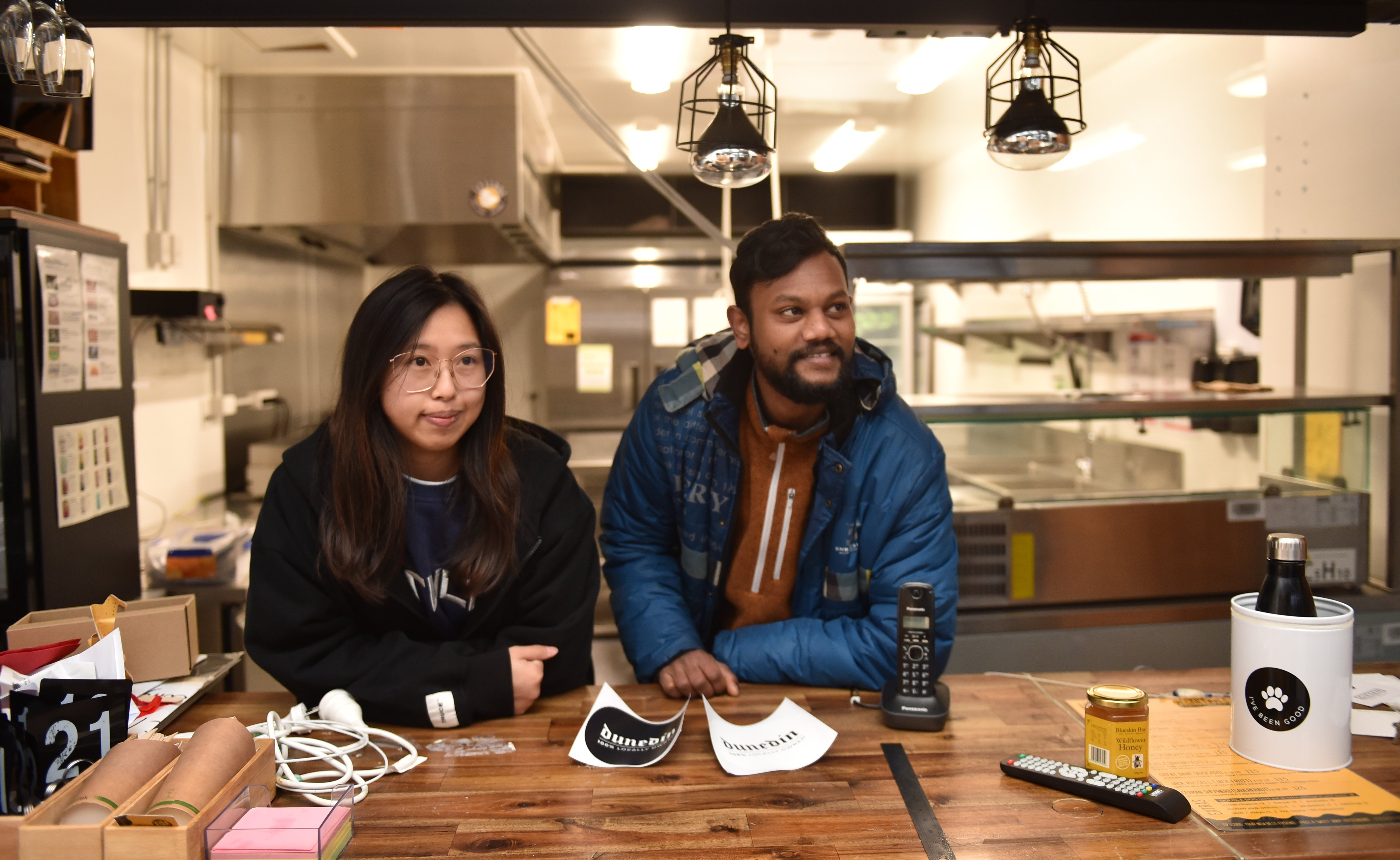 Judy Ling and Neeraj Kumar Mothuku  stand at the bar of  Burger N Beast restaurant, set to open...