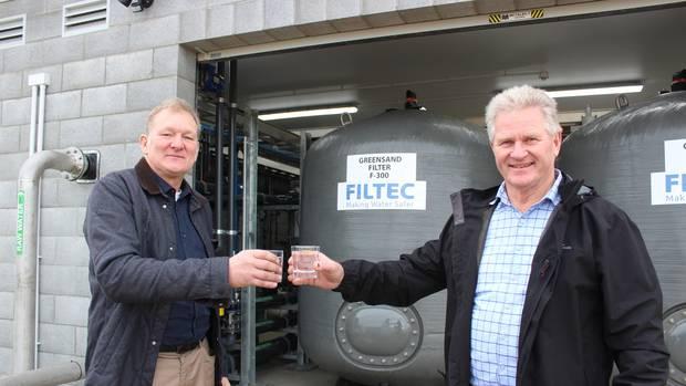 South Taranaki Deputy Mayor Rob Northcott (left) and Mayor Phil Nixon toast Waverley's new water...
