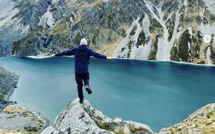 Standing above Lake Constance at the top of Waiau Pass on around Day 110. Photo: Jono Hartland...