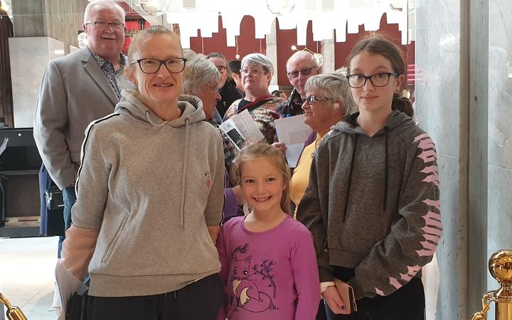 Vanessa Davidson and her daughters, Jessie and Maddison, were at the head of the queue. Photo:...