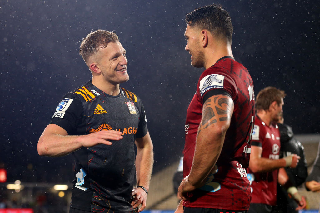 Damian McKenzie of the Chiefs talks with Codie Taylor of the Crusaders. Photo: Getty Images