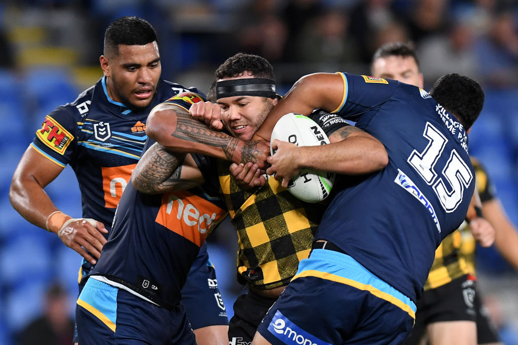 The Warriors' Jazz Tevaga is caught by the Gold Coast defence. Photo: Getty Images