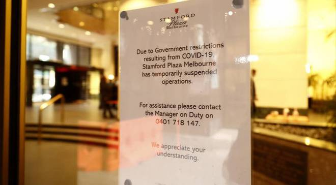 Signage outside the Stamford Plaza announcing the suspension of operations. Photo: Getty Images