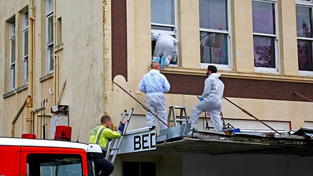 Police at the Whanganui flat where Lorna-Anne Marie Thompson's body was found in April last year....