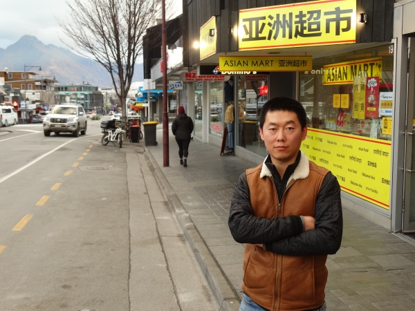 Asian Mart owner Tau Su on the loading zone/taxi stand outside the Shotover St store. Photo:...