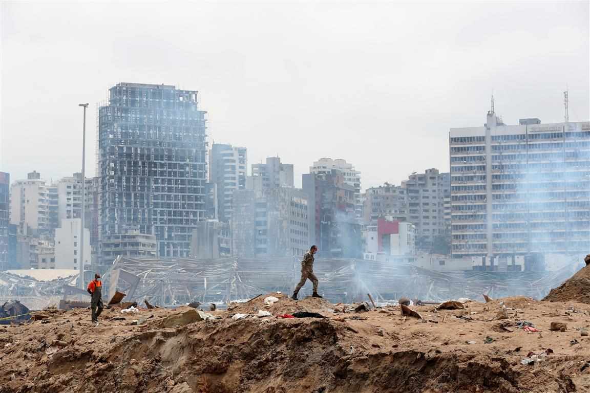A soldier walks at the explosion site at the port of Beirut. Photo: Reuters