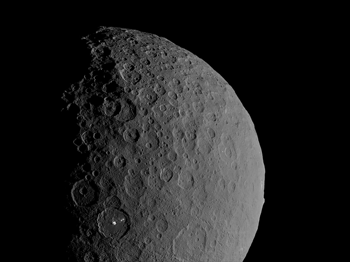 Occator Crater and Ahuna Mons appear together in this view of the dwarf planet Ceres obtained by...