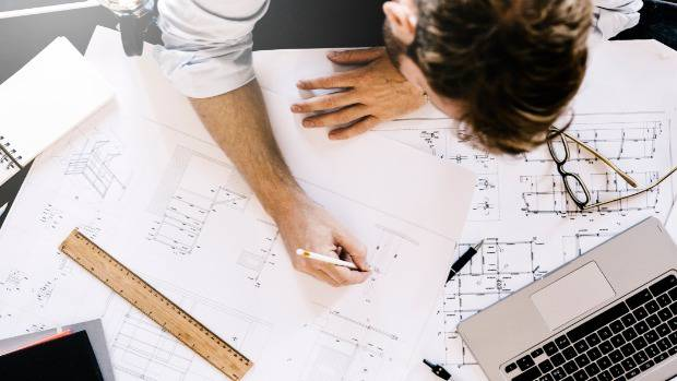 A top architect has lost his job after claiming a project had been put on hold while secretly...