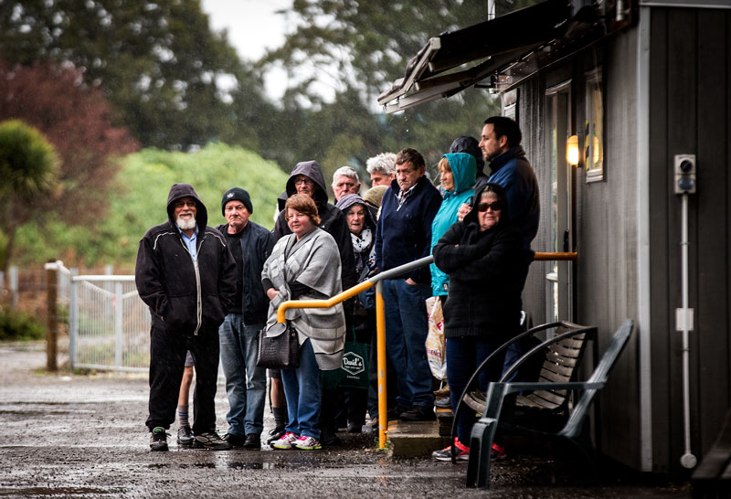 People wait in the rain for the Hospital Shuttle back in 2017. Photo: Martin Hunter