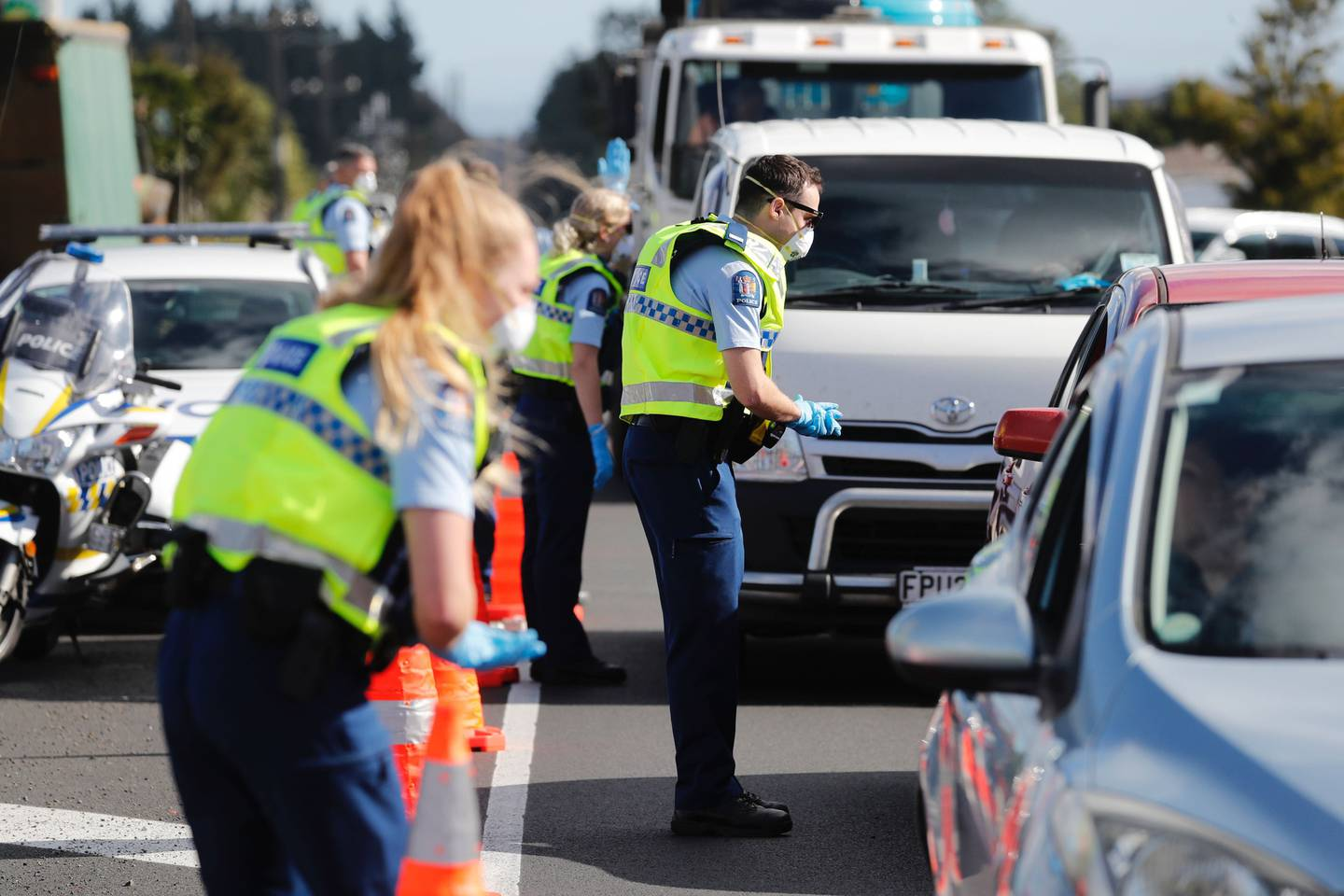 Police speak to motorists on the southern motorway at Bombay near Auckland after setting up...
