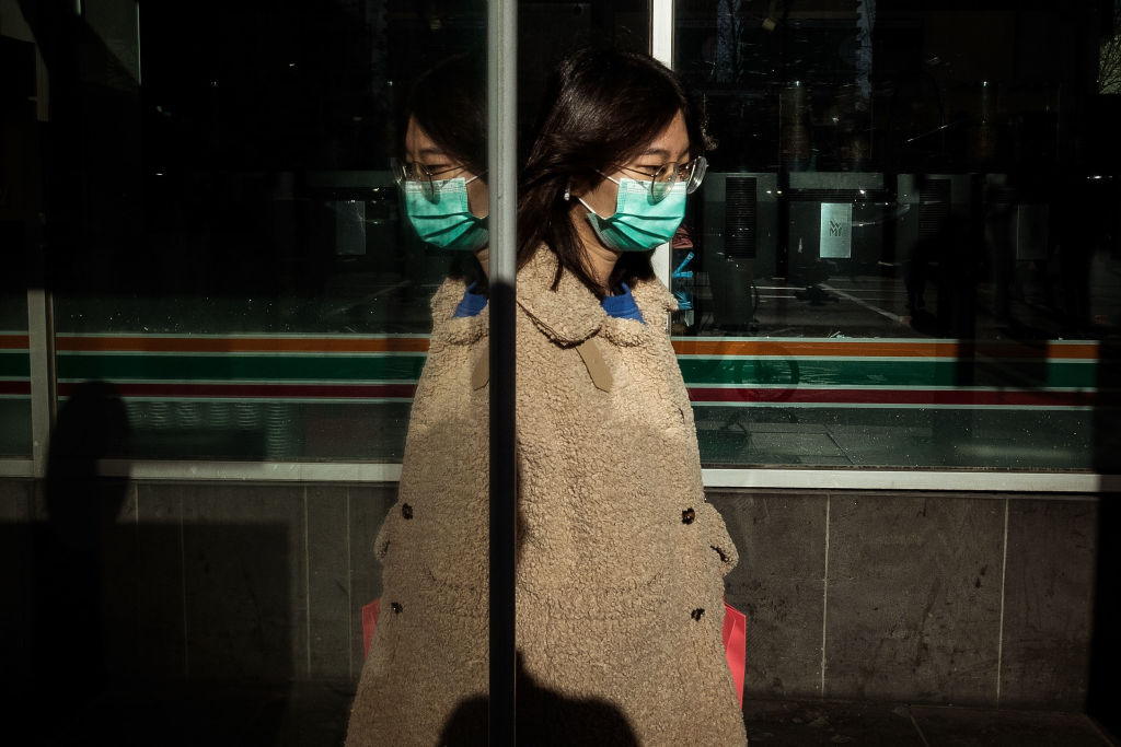 A woman in a face mask in central Melbourne. Photo: Getty