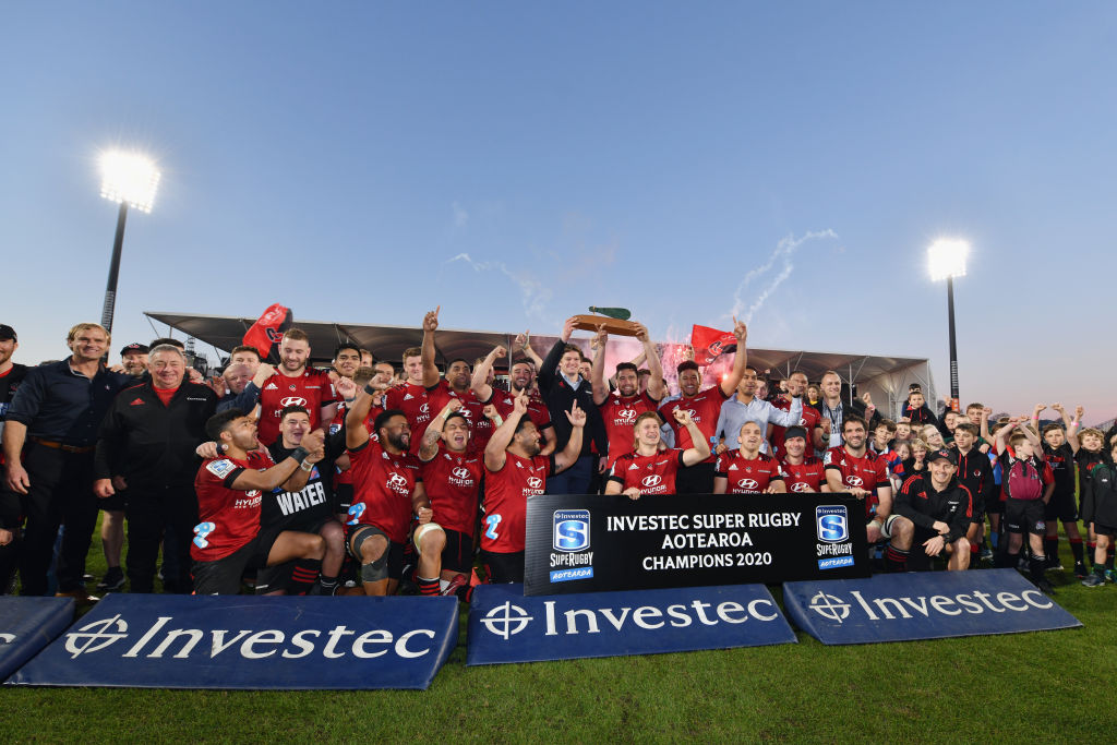 The Crusaders celebrate with the Super Rugby Aotearoa trophy after their win over the Highlanders...