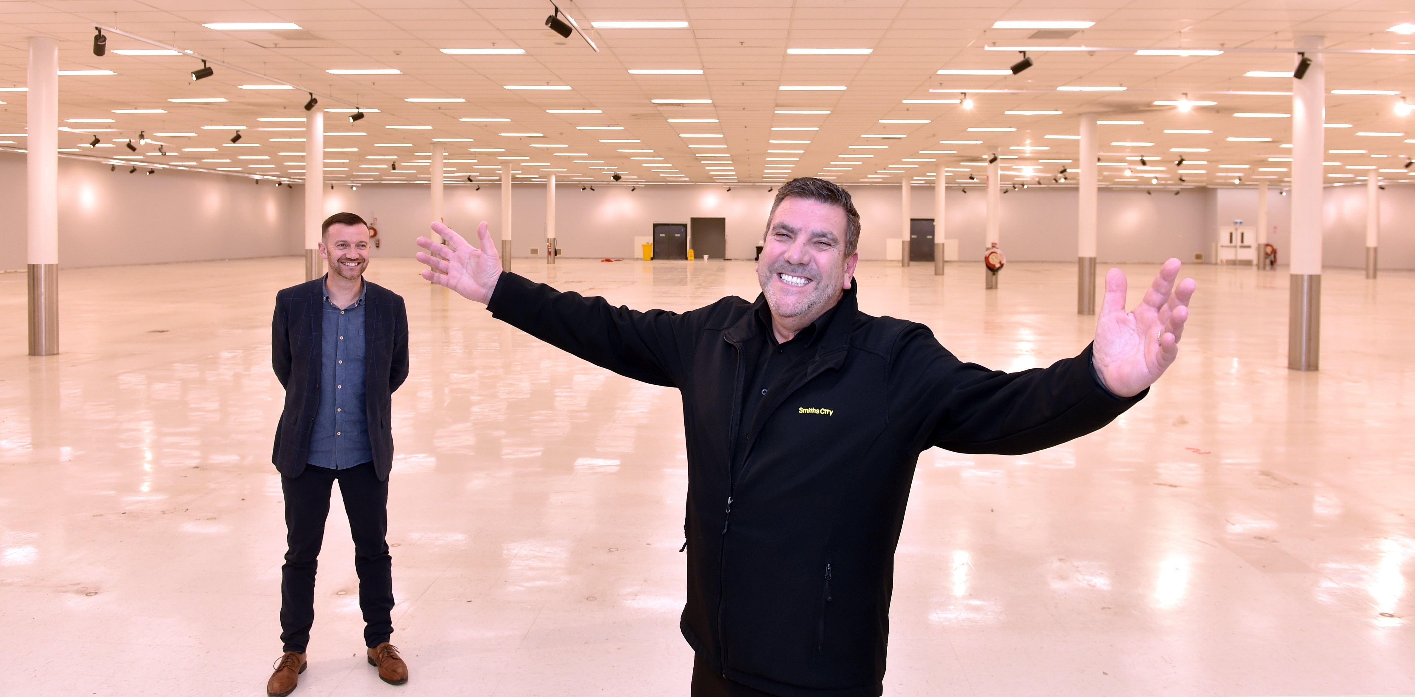 Smiths City store manager Gordon Wiffen (right) and Meridian Mall manager Regan Bennett in the...
