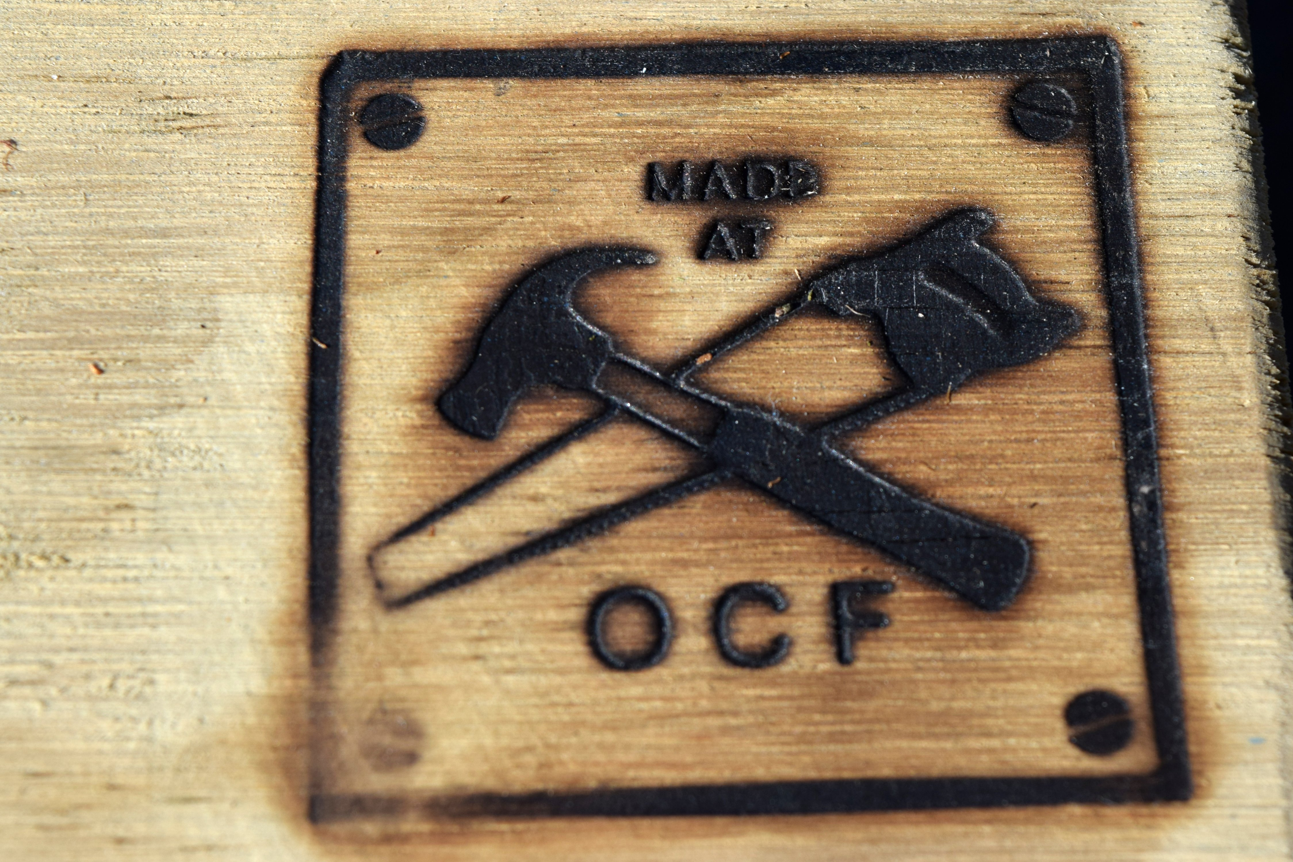 A brand on a stoat trap made by Otago Correctional Facility prisoners.