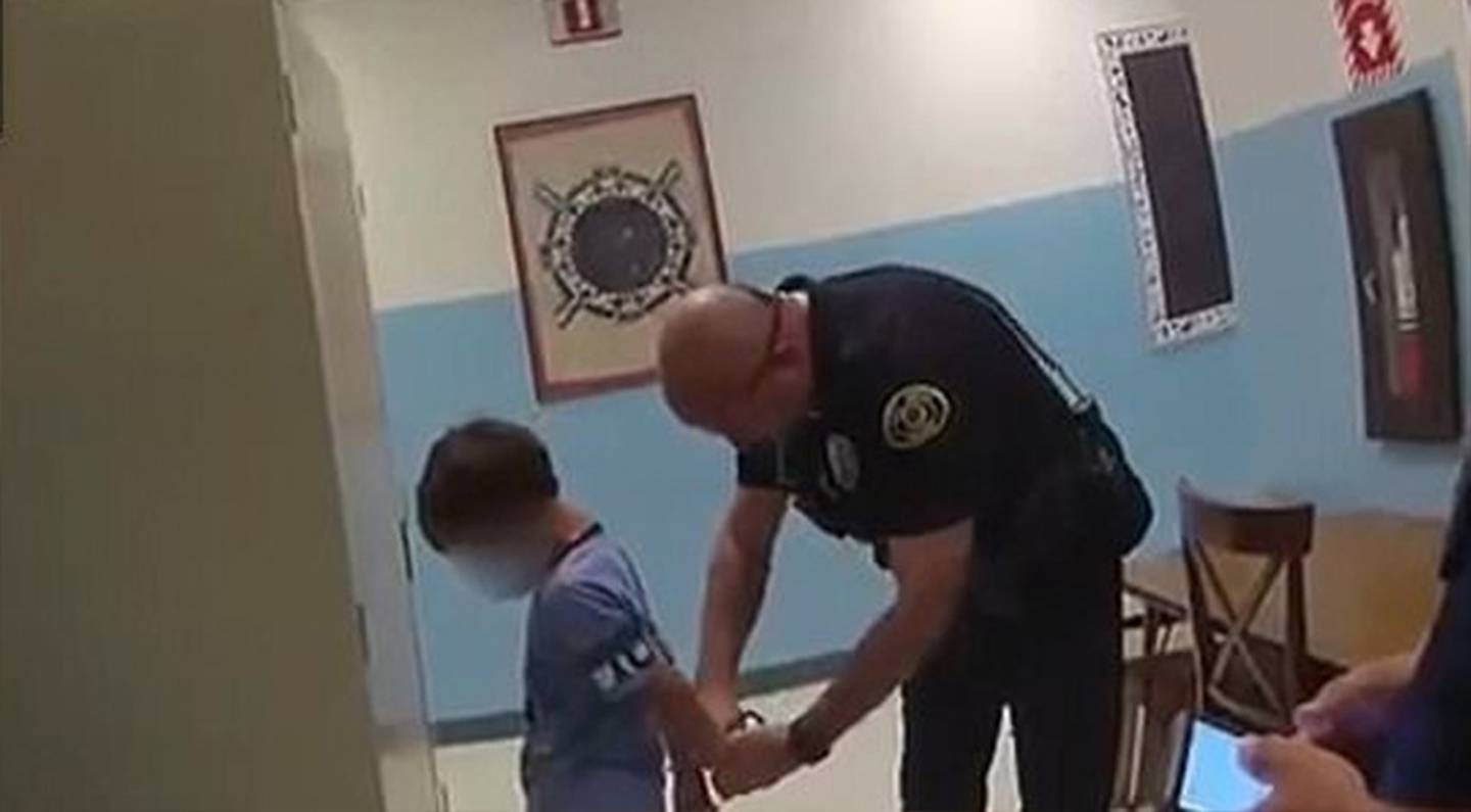 The officers told the child he's going to jail as they tried to put him in handcuffs but they...