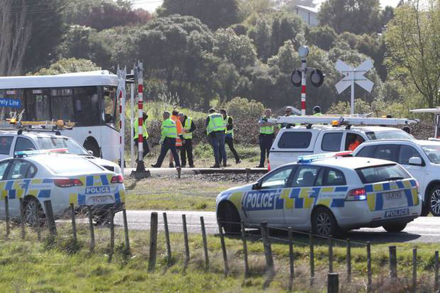 Emergency services at the crash scene yesterday. Photo: NZ Herald