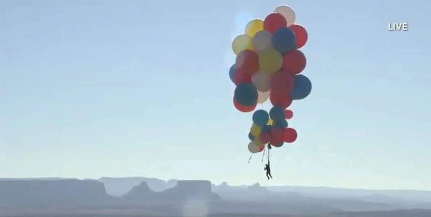 He didn't even put his parachute on until he was approximately halfway up! Photo: David Blaine