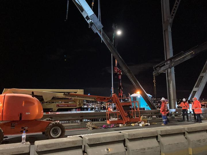 Workers repairing the bridge strut last night. Photo: Supplied / Waka Kotahi NZTA