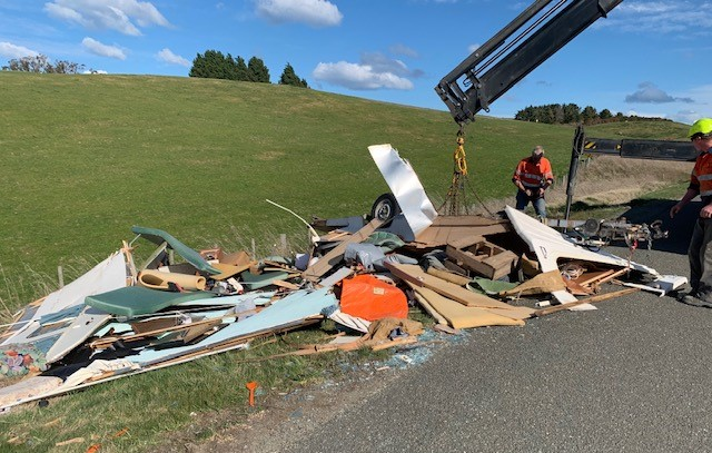 The caravan was blown off the highway yesterday afternoon. Photo: supplied